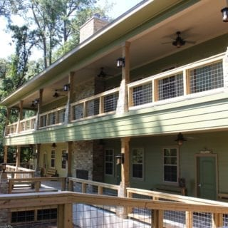 Exterior view of Camp Olympia two-story cabins and walkway.