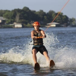 A young male camper water skiing on Lake Livingston.